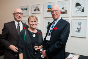 Library board member Geoff Dowd, Kathryn McKnight and Michael Harrison. Aislin cartoons donated by Terry Mosher.