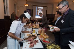 Library board member Jim McRae at the popular smoked meat station